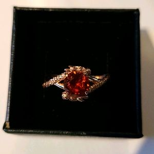 Silver ring with deep orange crystal